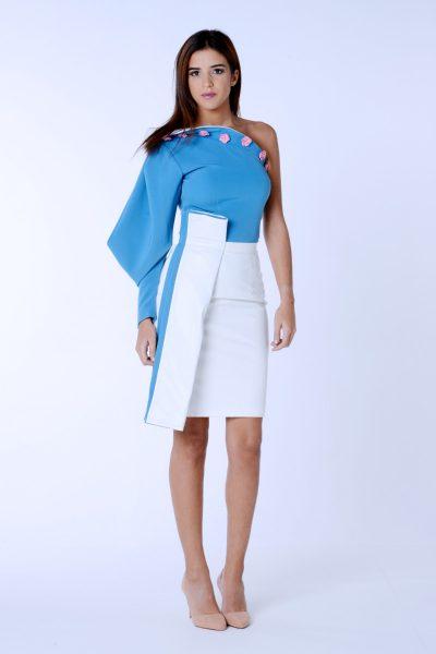 Falda de polipiel blanca con pliegre de la colección Dama blanca.Confeccionada en crep elástico y polipiel.Diseñado y confeccionado de forma artesanal en España.